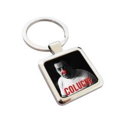 Porte-clés métal Affiche Exposition Coluche